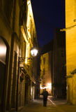 Gaslit Street. A narrow street, lit by gas lanterns, winds between medievil stone buildings in Sarlat, France Stock Photography