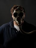 Gasmask. Man with gasmask before dark background Royalty Free Stock Images