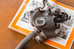 Gasmask on a book for children. Closeup Stock Images