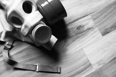 Gasmask bw. Gasmask on wooden floor in black royalty free stock photography