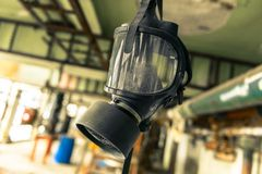 Gasmask hanging from cieling Stock Photo