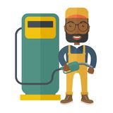 Gasoline boy with gas pump Royalty Free Stock Image