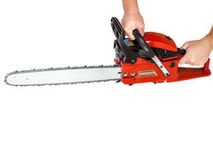 Gasoline chain saw in hand. Royalty Free Stock Image