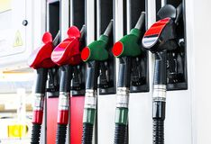 Gasoline and diesel distributor at the gas station. Gas pump nozzles. Petrol filling gun close-up at the gas station. Colorful Pet. Rol pump filling nozzles royalty free stock images