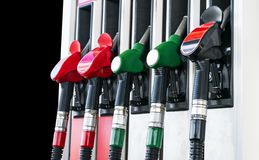 Gasoline and diesel distributor at the gas station. Gas pump nozzles. Petrol filling gun close-up at the gas station. Colorful Pet stock photography