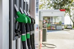 Gasoline and diesel distributor at the gas station. Gas pump nozzles Royalty Free Stock Image