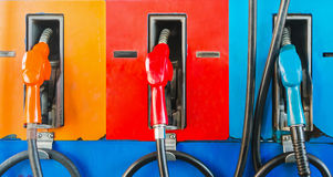 Gasoline dispenser. Colorful fuel oil gasoline dispenser at petrol filling station Royalty Free Stock Image