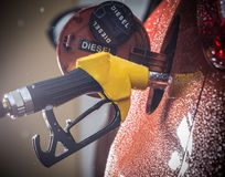 Gasoline dispenser in the car. Stock Photos