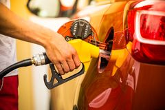Gasoline dispenser in the car. Royalty Free Stock Image