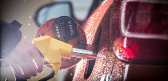 Gasoline dispenser in the car. Stock Image