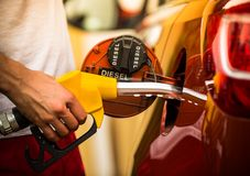 Gasoline dispenser in the car. Royalty Free Stock Photos
