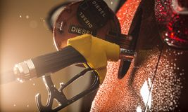 Gasoline dispenser in the car. Gasoline dispenser in the car, close-up Royalty Free Stock Images