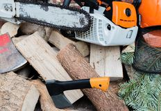Gasoline driven chain saw on a wooden stack stock photos