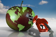 Gasoline and Earth fruit. Concept image with world map on an apple filling up with fuel Stock Photos