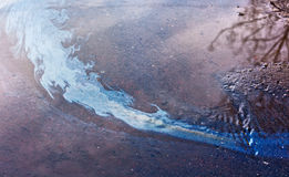Gasoline film on the surface of the water Royalty Free Stock Image