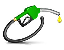 Gasoline fuel nozzle. Giving a drop Royalty Free Stock Photography