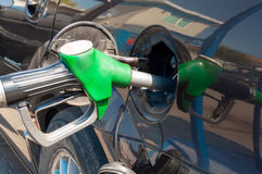 Gasoline. The hose is inserted into the fuel tank opening Royalty Free Stock Images