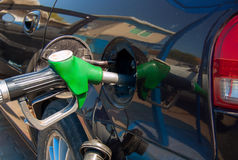 Gasoline. The hose is inserted into the fuel tank opening Stock Photos