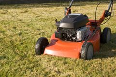 Gasoline lawnmower. Lawn-mower on the turf Stock Image