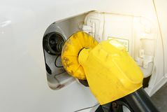 Gasoline nozzle for car refueling at gas station. Gasoline nozzle for car refueling at gas station Royalty Free Stock Photos