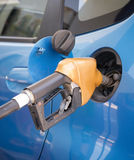 Gasoline nozzle filling up a car Royalty Free Stock Images