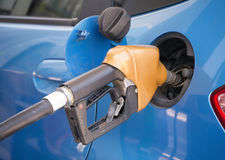 Gasoline nozzle filling up a car Stock Photography