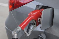 Gasoline Nozzle. Fossil fuel going into a car Royalty Free Stock Photography