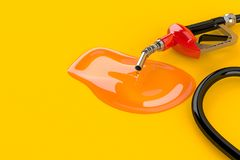 Gasoline nozzle with spilled gasoline Royalty Free Stock Images