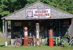 Gasoline and oil history. WELLS, MAINE - CIRCA SEPTEMBER 2009: Old Gas Pumps, tractors and signs at Johnson Hall Museum on Route 1 in Wells, Maine Stock Photo