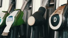 Gasoline or petrol station gas fuel pump nozzle hang. Gasoline or petrol station gas fuel pump nozzle stock footage