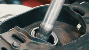 Gasoline pistol is poured into a fuel tank of motorcycle, close up view. Gasoline pistol is poured into the fuel tank of motorcycle, close up view stock video footage