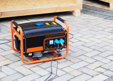 Gasoline Portable Generator on the  House Construction Site. Close up on Mobile Backup Generator. Standby Generator Royalty Free Stock Photos