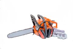 Gasoline powered modern chainsaw with protective gear Stock Photography