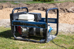 Gasoline Powered Portable Generator. At construction site Royalty Free Stock Images