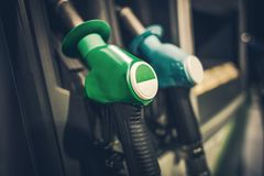 Gasoline Pump Nozzles. Closeup Photo. Gas Station Equipment. Car Refuel Concept Royalty Free Stock Photos