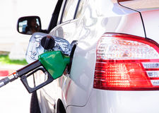 Gasoline refill. Close up scene of gasoline car refilling Royalty Free Stock Image