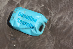 Gasoline Scarcity. A can of petrol lies empty on the beach sands after gas stations go on strike in India Royalty Free Stock Images