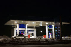 Gasoline station. Kind on a gasoline station in the winter at night Royalty Free Stock Photo