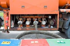 Gasoline tanker gives gasoline Stock Photos