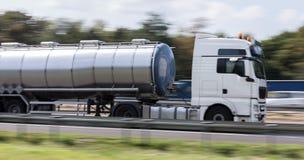 Gasoline transportation truck on highway speed blur. A gasoline transportation truck on highway speed blur stock photo