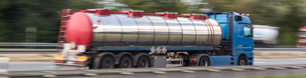 Gasoline transportation truck on highway speed blur. A gasoline transportation truck on highway speed blur Royalty Free Stock Images