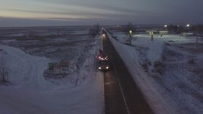 Gasoline truck moving along roadside on winter highway drone view. Gasoline truck moving along roadside on winter highway on background gas station drone view stock video footage