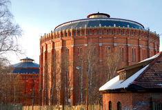 Gasometer. Old beautiful gasbell made of brick royalty free stock photography