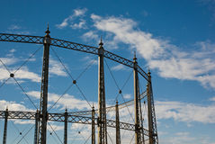 Gasometer against a Blue Cloudy Sky Stock Images