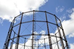 A gasometer against a blue sky Stock Photo