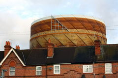 Gasometer and House Rooftops Stock Photo