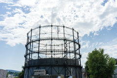Gasometer old industry heritage with sky and tree Stock Image
