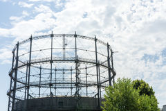 Gasometer old industry heritage with sky and tree Stock Photo
