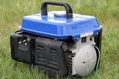 Gasonline generator. Close - up of gasonline generator on grass background Royalty Free Stock Photography