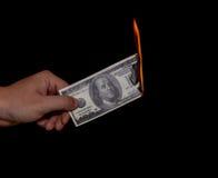 Gaspillage de l'argent Image libre de droits